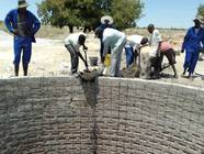 Trainees from Epyeshona and experts building an underground tank for rainwater harvesting
